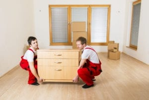 Movers in red moving furniture