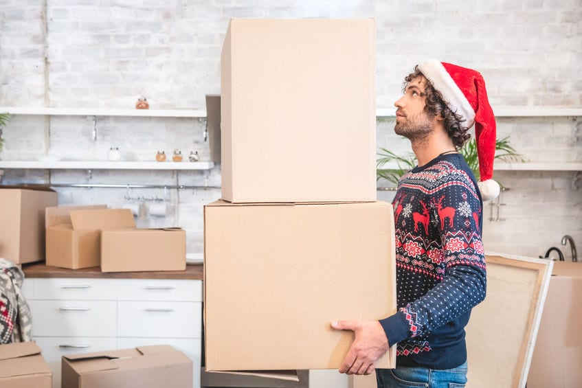 man moving during the holidays